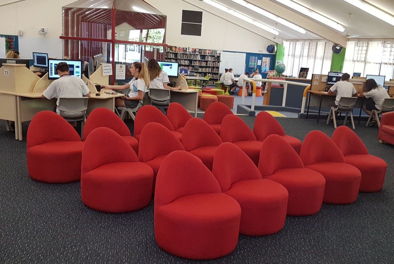 Our school library's distinctive red lounges for BYOD use and reading